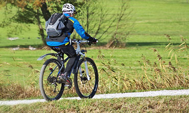 Bicyclist wearing wool thermals in the fall