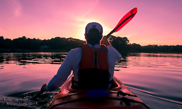 Man kayaking in mesh thermal outerwear